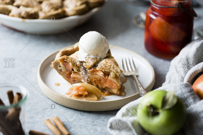 Piece of apple and quince lattice pie with a scoop of ice cream