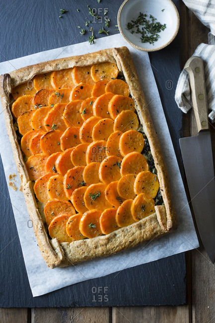 Fresh baked sweet potato galette and bowl of herbs