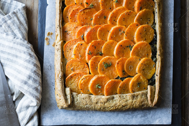 Fresh baked sweet potato galette on parchment paper