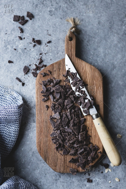 Chopped chocolate on a wooden cutting board