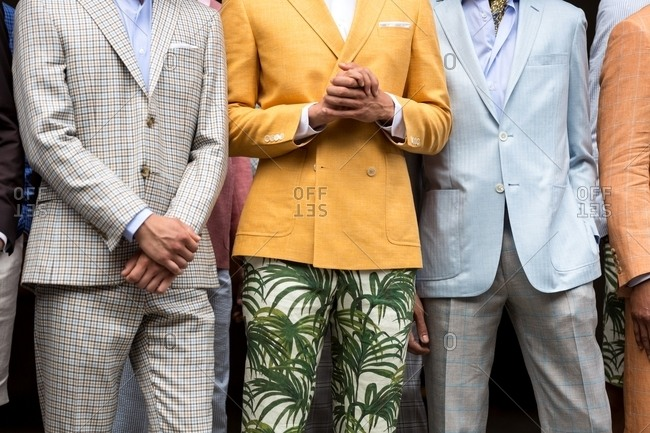 Men modeling various patterned suits