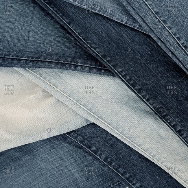 Legs of various colored denim jeans