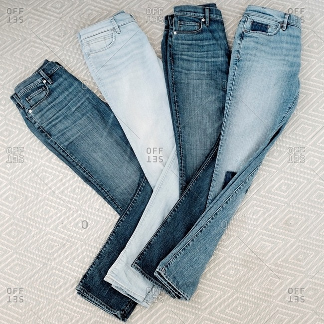 Various shades of denim jeans folded and fanned out