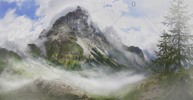 Cimon della Pala  and Passo Rolle surrounded in clouds