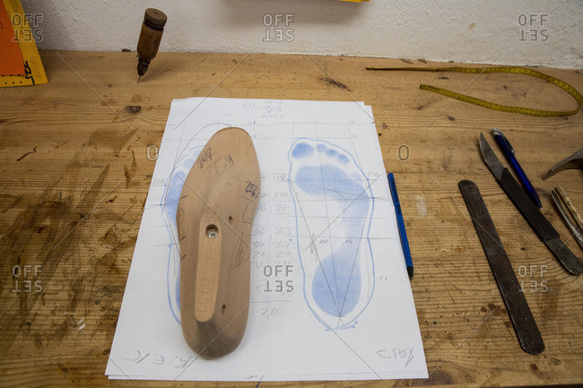 Paper with footprint and foot outline in a shoemaker's workshop