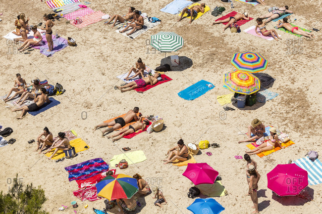Majorca Island, Spain - October 13, 2016: Beachgoers on the coast of Cala Pi, Majorca Island in the Balearic Islands, Spain