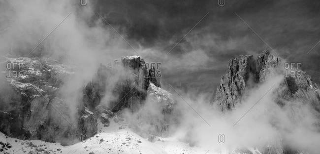Clouds between the mountains of the Dolomites