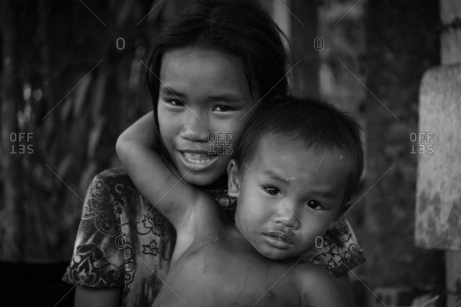 Siem Reap, Cambodia - October 13, 2016: Siblings in Siem Reap, Cambodia