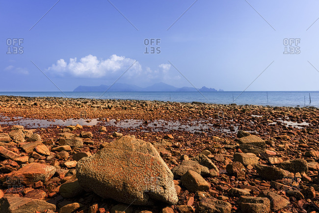 Beach covered in red stones