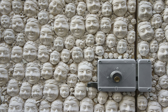 Gypsum heads in an exterior door, Funchal, Portugal