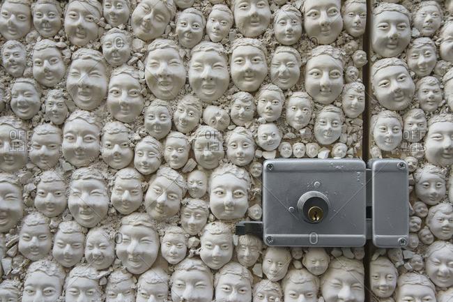 Gypsum heads in an exterior door, Funchal, Portugal