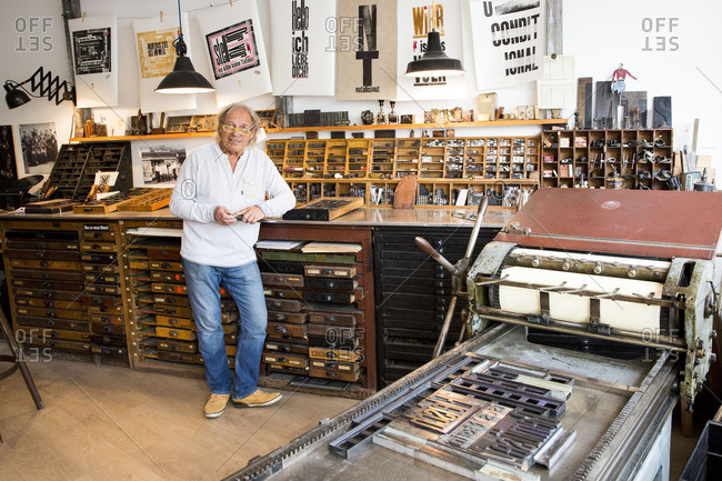 Hamburg, Germany - October 13, 2016: Typesetter standing in his printing shop