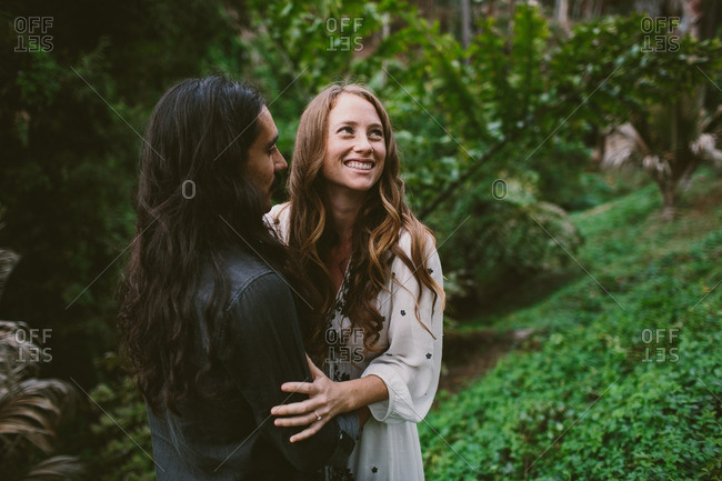 Couple embracing and smiling in a park