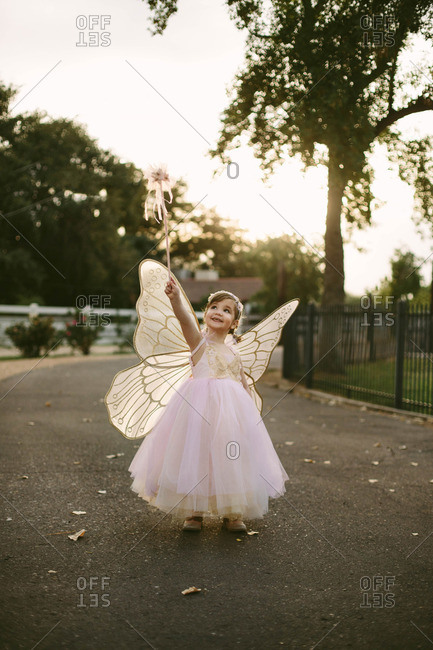 Girl in fairy costume holding wand