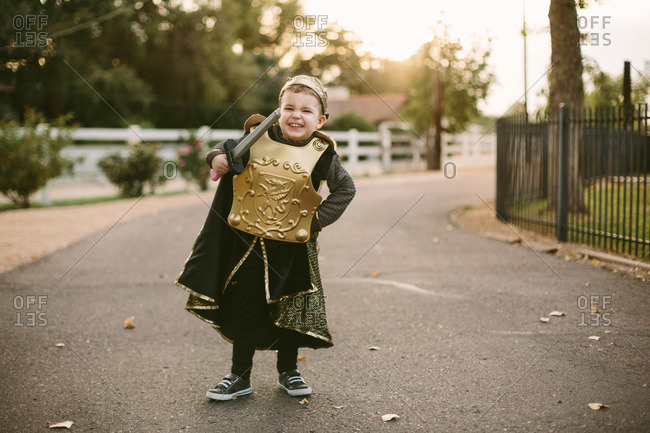 Boy in street in knight costume