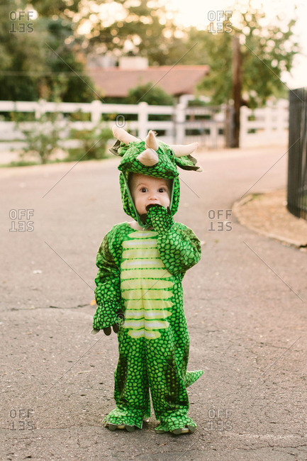 Boy in street in dragon costume