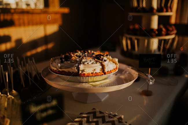 Cake stand with a buckeye pie on a dessert table