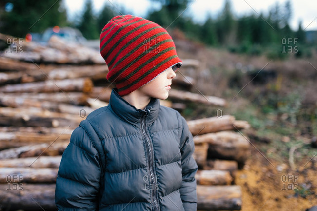 Portrait of boy in rural logging setting