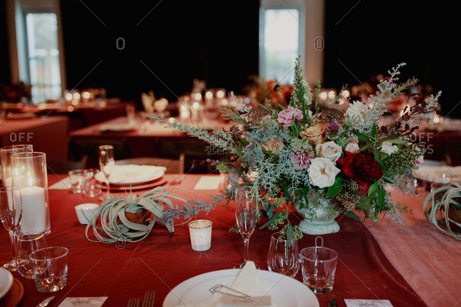 Tables set with desert plants and floral arrangements for wedding reception