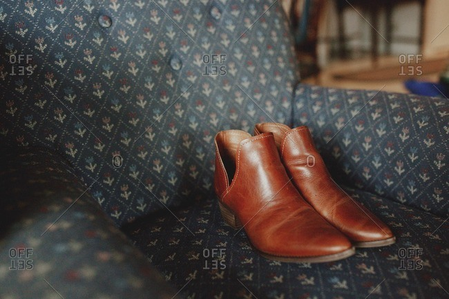 Western-style booties on chair