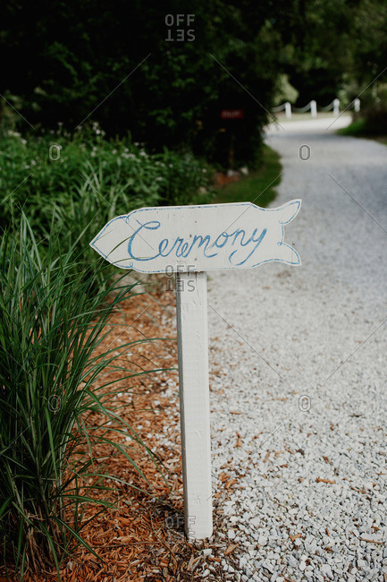 Hand painted sign directing guests to ceremony