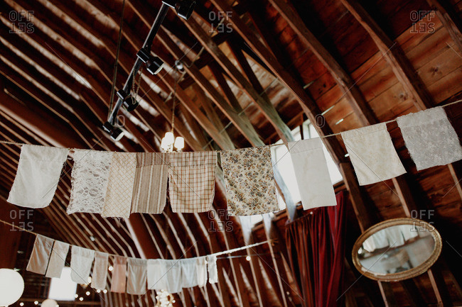 Rustic cloth banners hang from barn rafters