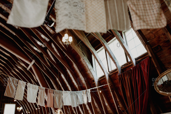 Cloth banner decorations hang from barn rafters