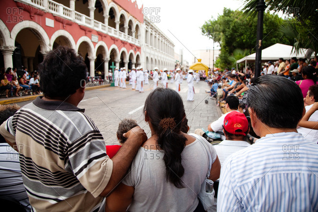 Merida, Yucatan - June 26, 2011: Crowd watching Jarana dancers in the streets of Merida