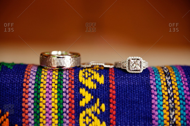 Wedding rings on a colorful woven fabric