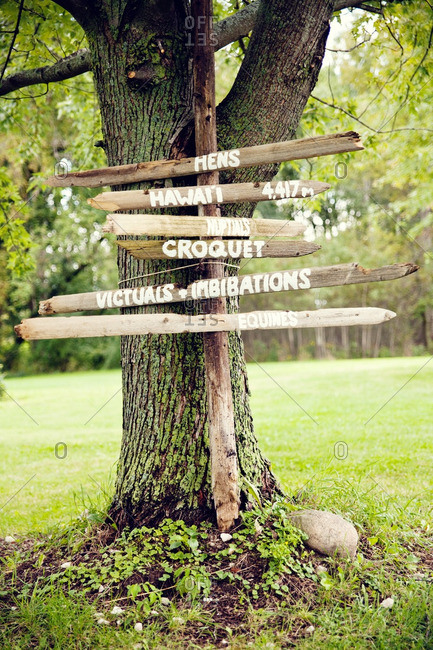 Wooden directional sign at a wedding