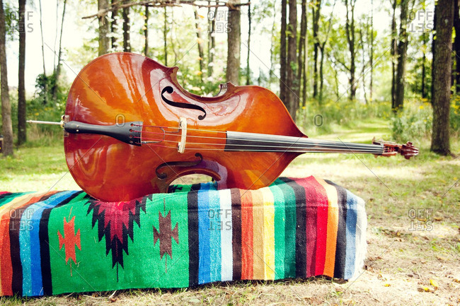 Cello on a colorful woven fabric