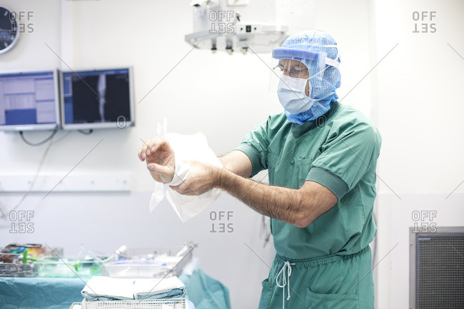 Surgeon drying off arms