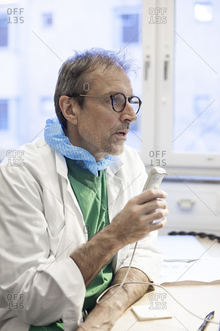 Doctor speaking into a dictaphone
