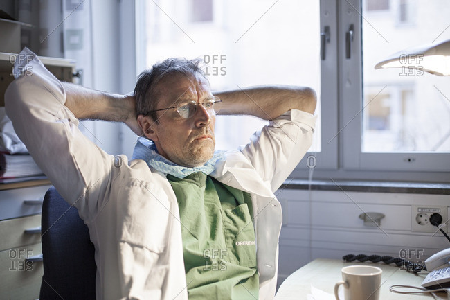Doctor thinking sitting in office