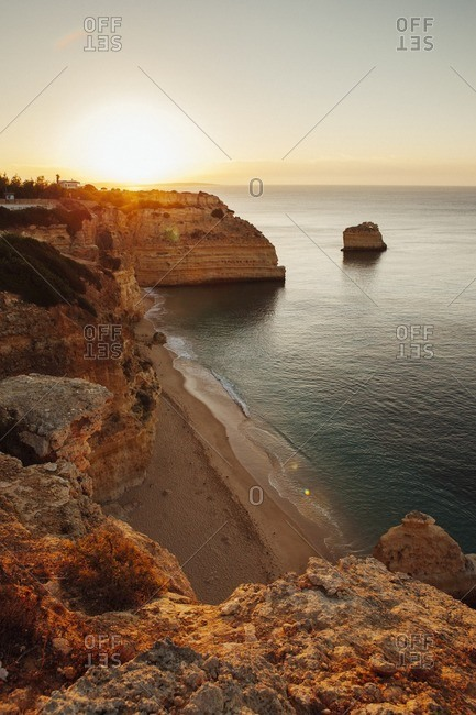 Scenic view of cliff by sea against sky at Praia da Marinha
