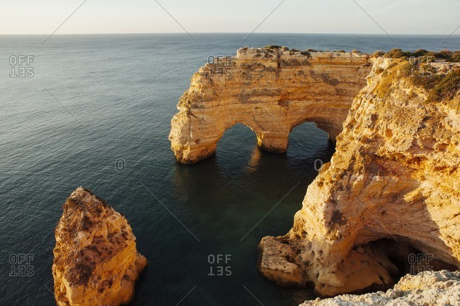 Scenic view of natural archs amidst sea at Praia da Marinha