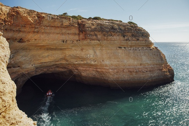 High angle view of boat moving on sea at Praia da Marinha against sky