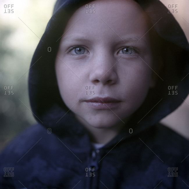 Portrait of boy in hooded shirt
