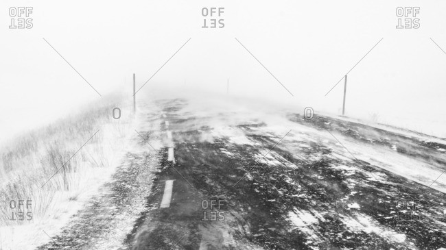 Snow covered road during foggy weather