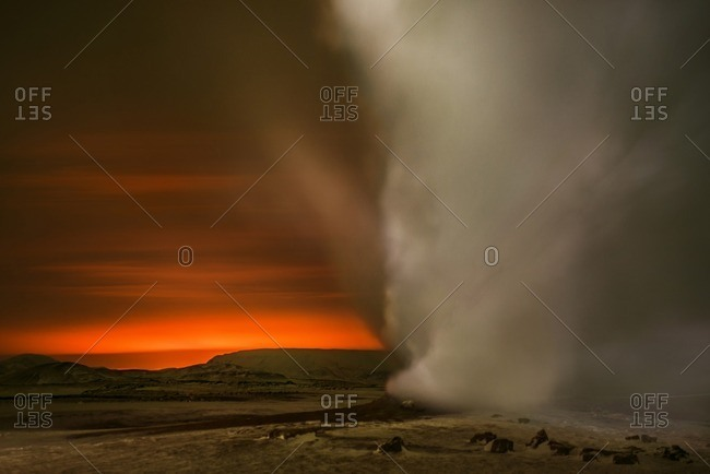 Fumaroles emitting steam during sunrise
