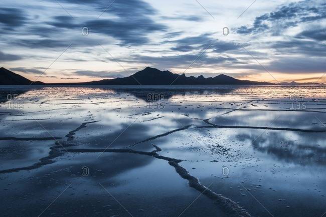 View of the Bonneville Salt Flats against cloudy sky during sunset