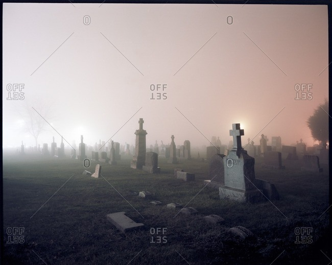 Graveyard against sky during foggy weather