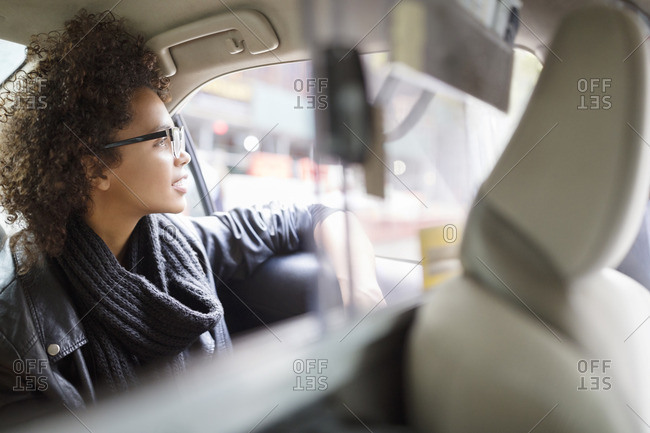 Woman looking away while traveling in car