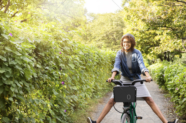 Happy woman riding bicycle in park