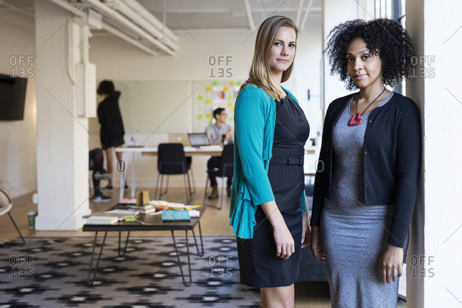Portrait of confident multi-ethnic businesswomen at office