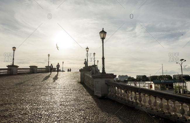 Antwerp, Belgium - August 5, 2016: People crossing old footbridge