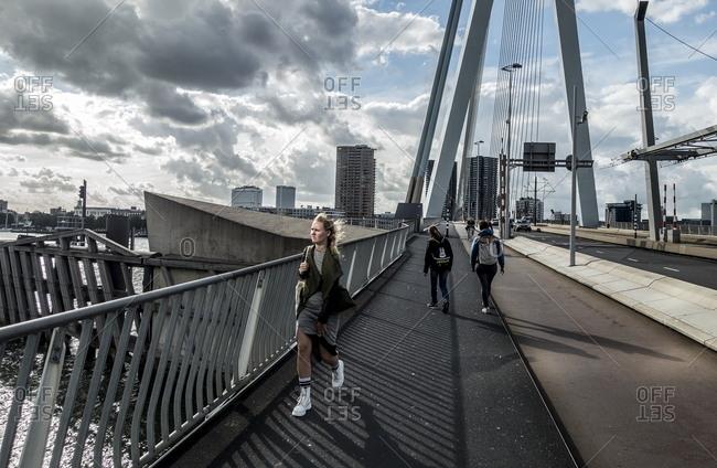 Rotterdam, Netherlands - August 8, 2016: People crossing Erasmusbrug bridge