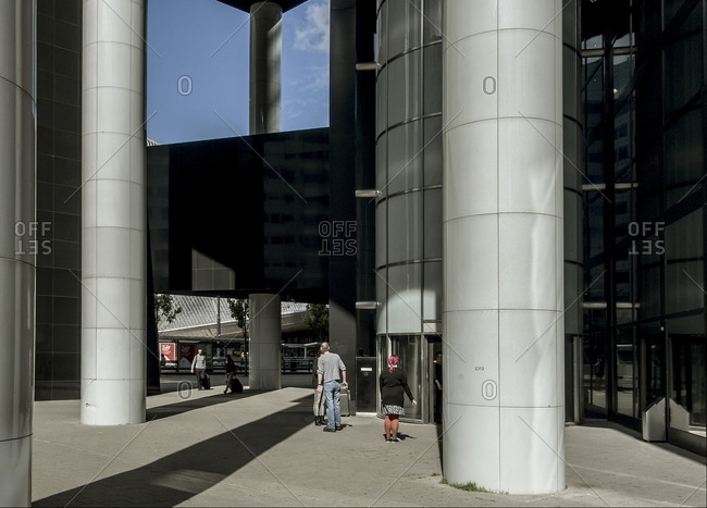 Rotterdam, Netherlands - August 10, 2016: People outside modern office building