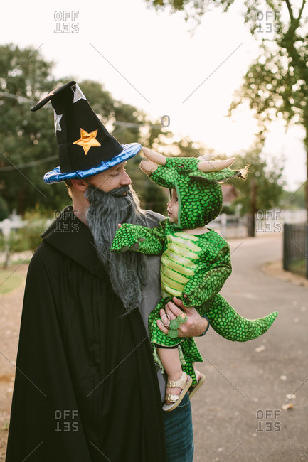 Man and baby in costumes together