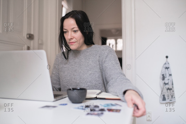 Woman on laptop working at home